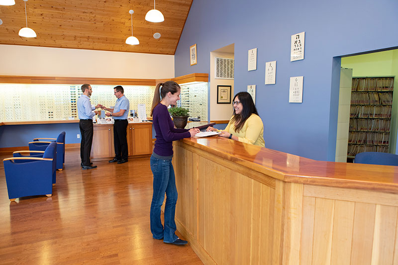 White Salmon Eyecare Front Desk Patient receiving paperwork